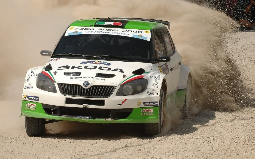 Green and white rally car in San Marino