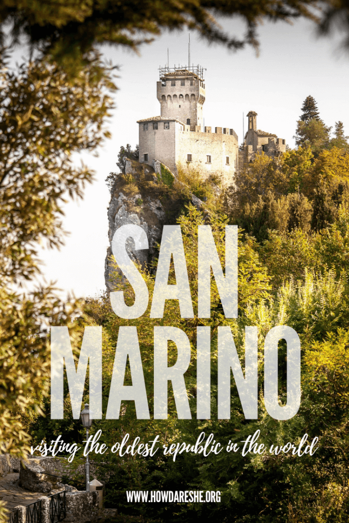 second tower of San Marino historic city center through trees