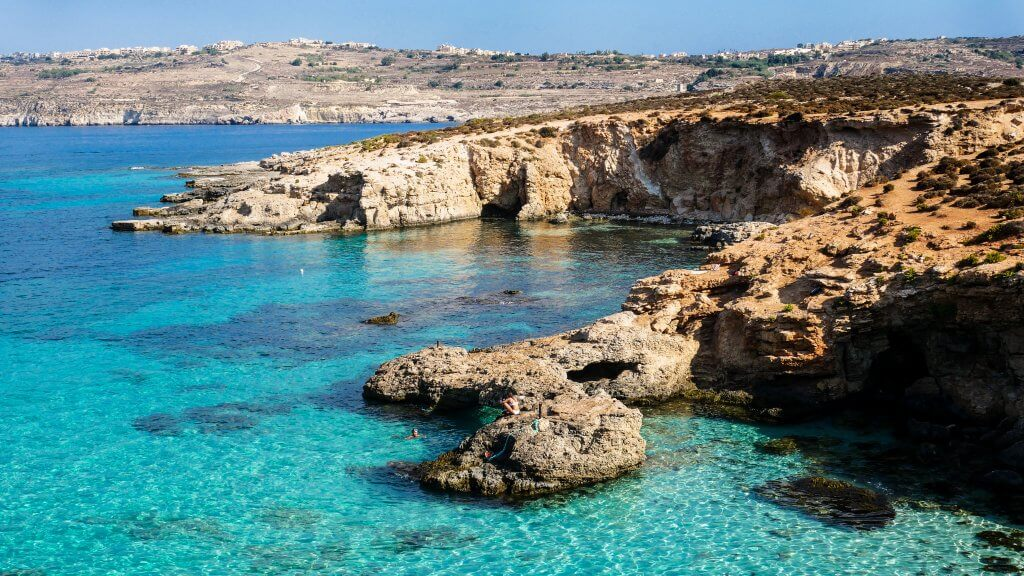 cliffs and turqouise waters in blue lagoon comino malta