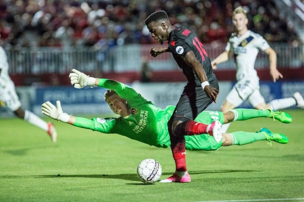 Diving goalie and striker at Phoenix Rising soccer game