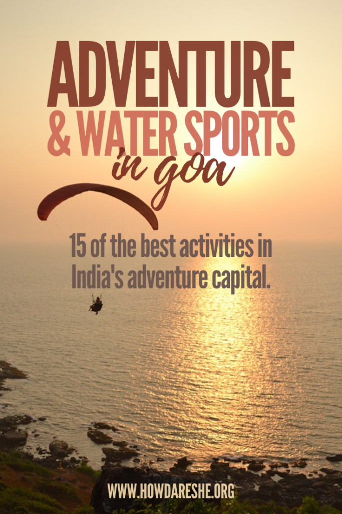 "Text ""Adventure & water sports in Goa; 15 of the best activities in India's adventure capital."" over a sunset image with the yellow sun reflecting off of the water and silhouette of paragliders"