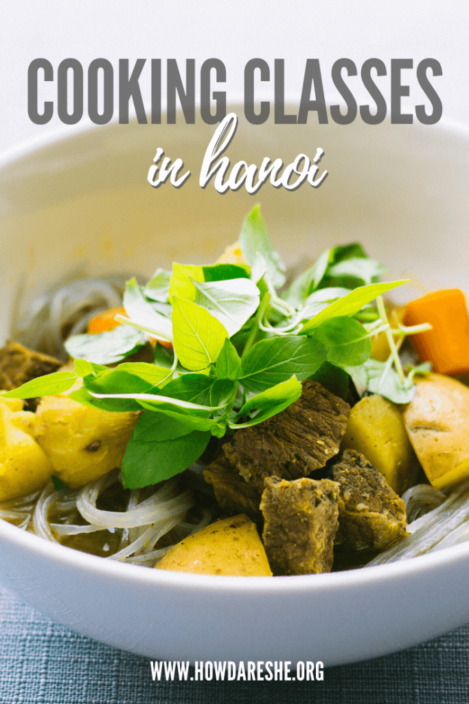 text cooking classes in hanoi over image of large white bowl with meat, vegeatables and noodles