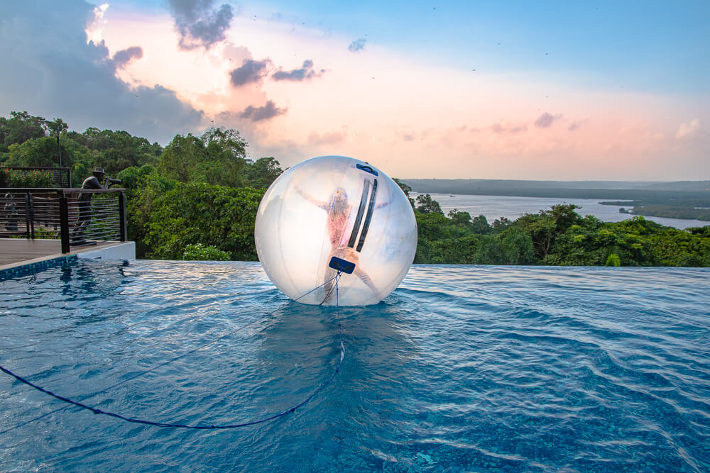 Zorb in infinity pool with pink sunset in the background