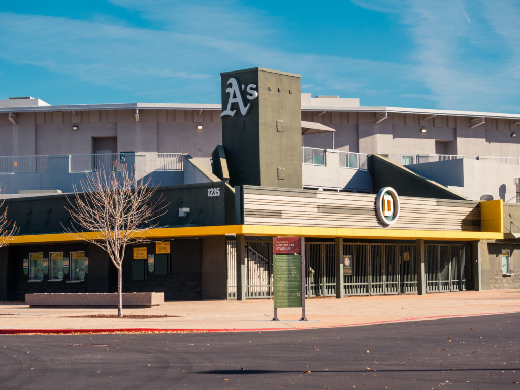 Hohokam Stadium from the north, with a green and yellow paint scheme and the Oakland Athletics A