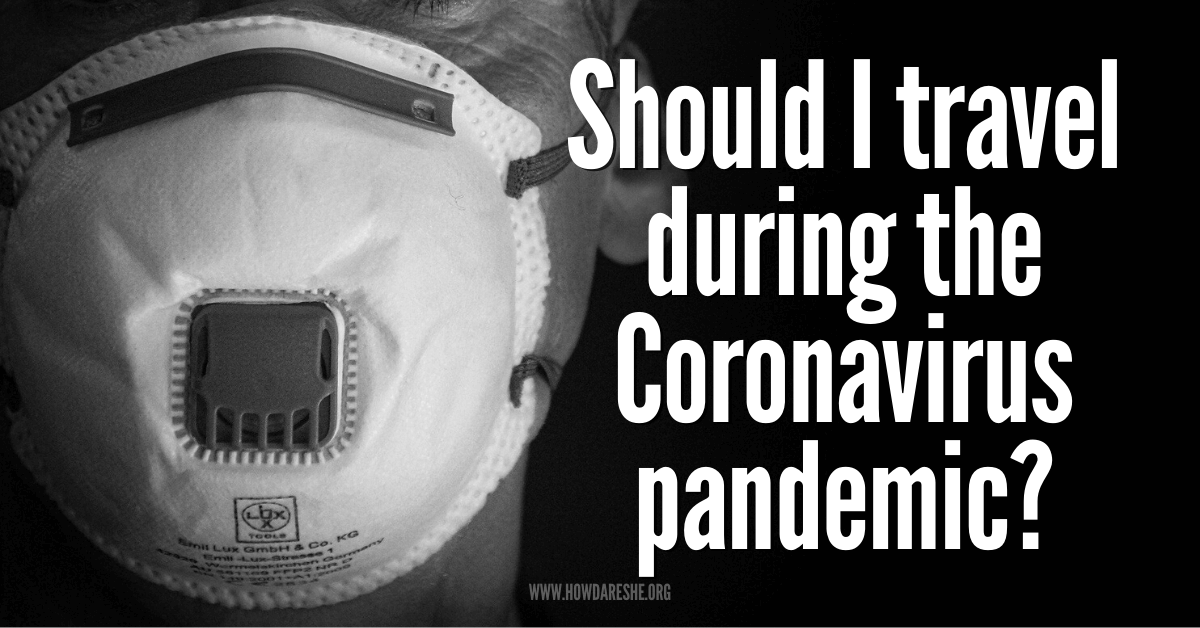 "Text ""Should I travel during the Coronavirus pandemic?"" overlayed on black background with black and white image of man wearing an anti-viral mask"